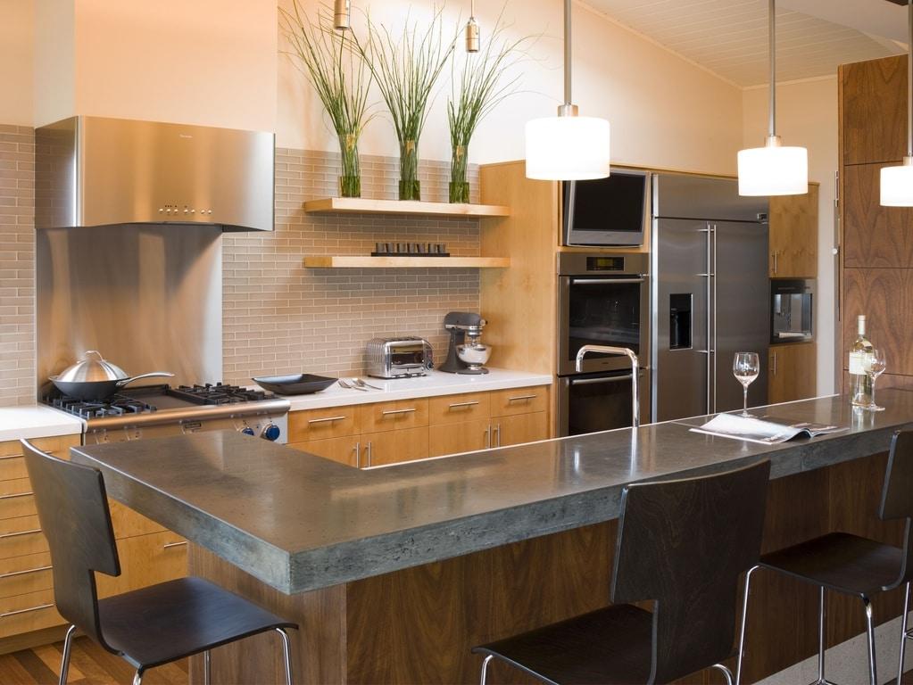 Cocinas modernas 50 fotos desde sencillas a for Mesa barra cocina