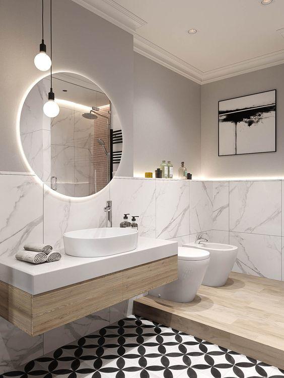 Un contraste entre 3 materiales para un baño minimalista pero cálido